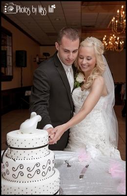 Couple cutting their wedding cake Saint Marys Cultural Center Wedding Photos by Miss Ann