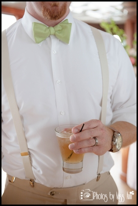 Groom with lime green bowtie and suspenders Infinity Yacht Wedding Iceland Wedding Photographer Photos by Miss Ann