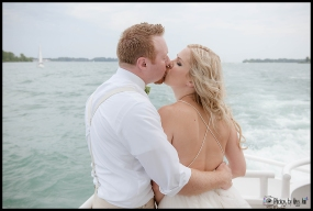 Wedding Day Kiss Couples Portraits Infinity Yacht Wedding Michigan Wedding Photographer