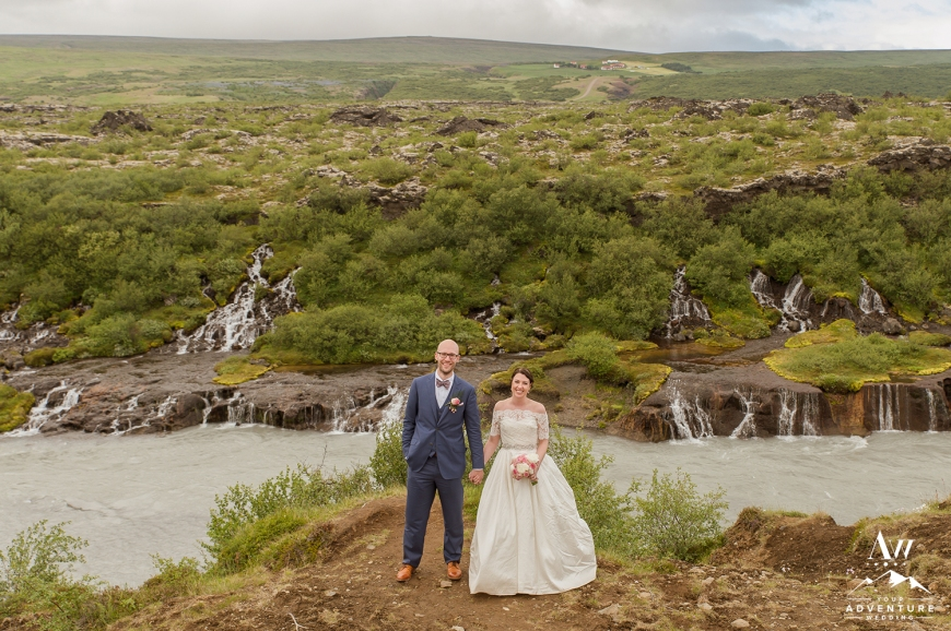 Icelandic Wedding - Couple at Hraunfossar Waterfall