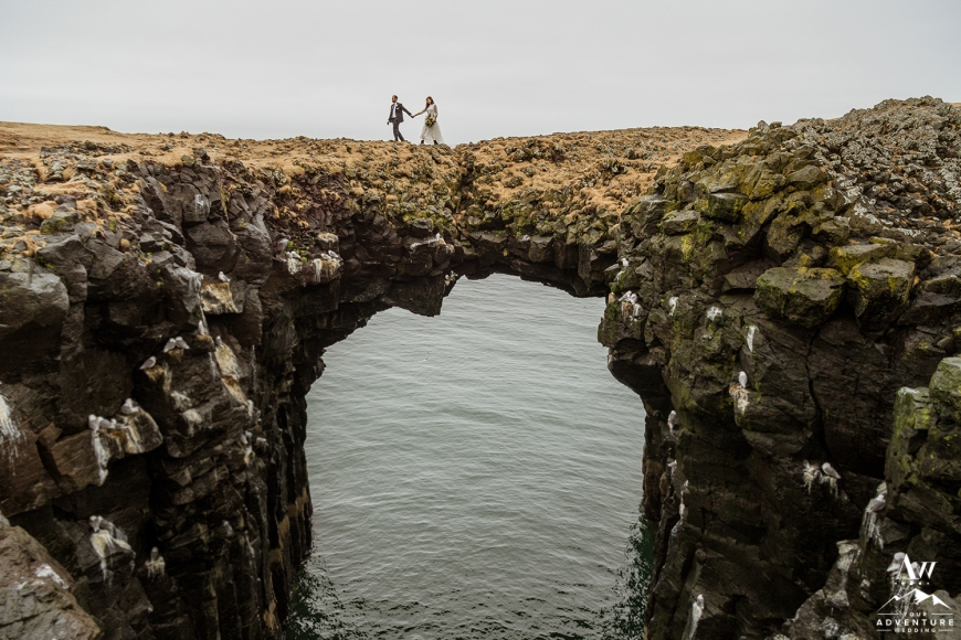 Iceland Wedding Photos on stone arch